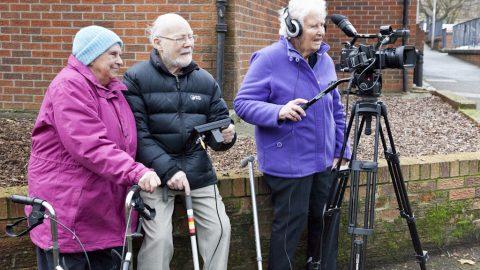 Three older participants filming
