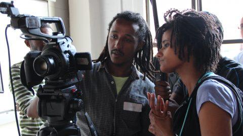 Participants looking at a video camera